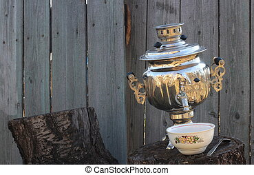 Old samovar and bowl on stump
