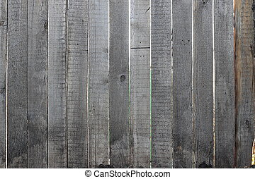 Grey wooden fence, close-up