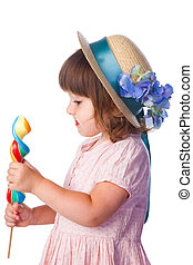 little girl with lollypop