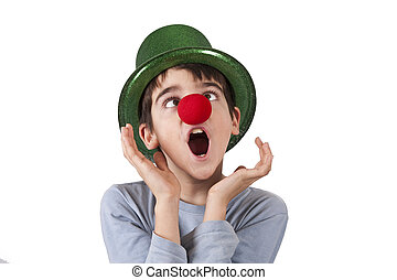 clown - boy with clown nose and hat isolated on white...