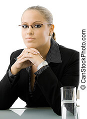 Businesswoman thinking at desk - Young attractive...