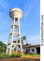 Water tank tower with blue sky and clouds