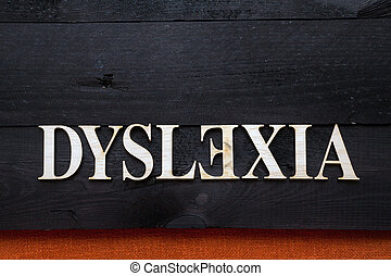Dyslexia concept - ''Dyslexia'' word with wooden letters on...