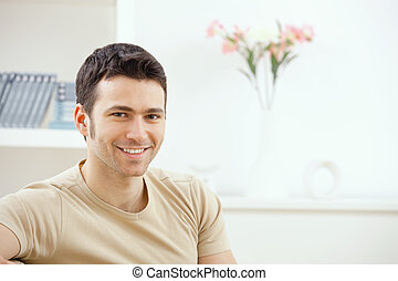 Young man at home - Happy young handsome man at home,...