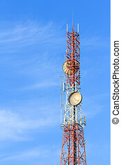 Communication tower on blue sky and clouds