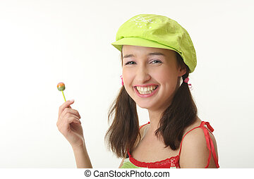 gir  - The girl in a green cap eats a sugar candy