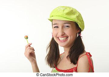 gir  - The girl in a green cap eats a sugar candy
