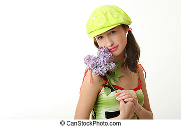 gir  - The girl in a green cap with a lilac bouquet