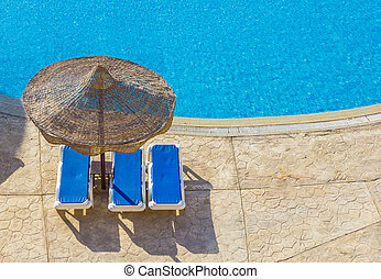 the pool, beach umbrellas and the Red Sea in Egypt - The...