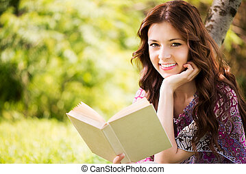Portrait of Girl with a book in the park - Beautiful Girl...