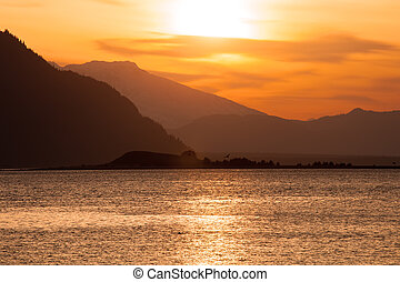 Hazy Chilkat Inlet sunset - Hazy skies at sunset on the...