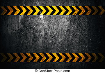 Asphalt background with black and yellow markings