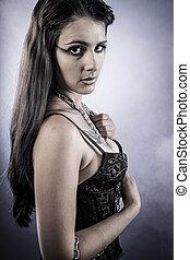 Make up, Sensual brunette dressed in black lingerie