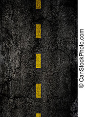 Road - Asphalt background texture with a divided yellow line