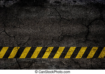 Asphalt background texture with construction signs