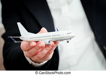 Business person holding airplane model. Transport, aircraft industry, airline