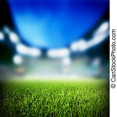 Football, soccer match. Grass close up, lights on the...