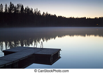 Jetty over lake - Serene scene with jetty photographed at...