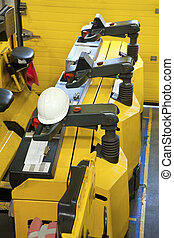 Tow tractors in the factory - Yellow Tow tractors in the...