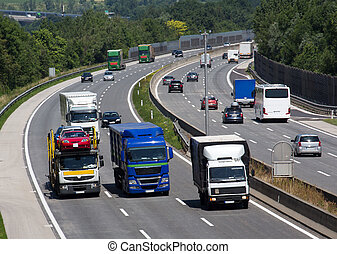 trucks on the highway - trucks on a three-lane motorway....