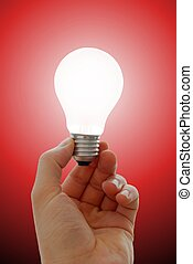Bulb - Glowing lightbulb in a hand