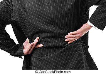 man with low back pain - man wearing a suit with his hands...