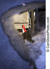 Polish flag in a puddle - Reflection of Polish Flag in a...