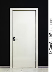 Modern closed white door and black wall