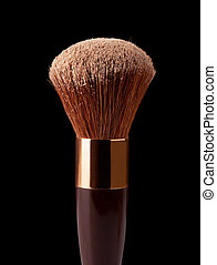 Makeup Brush and Powder on a black background