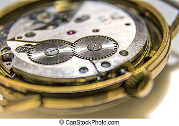 Watch mechanism - Close up of golden, antique watch...