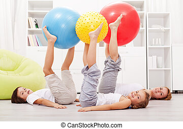 Healthy family exercising at home