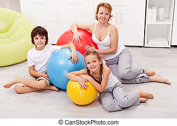 Happy woman and kids exercising at home