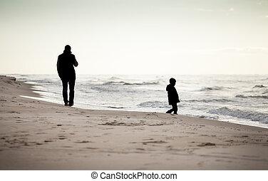 Autumn walk on a beach - Father and son on a beach