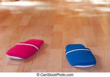 Slippers - Red and blue slippers on parquet floor