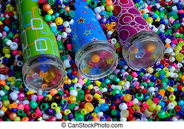 Kaleidoscopes in beads - Toy kaleidoscopes nestled in a bed...