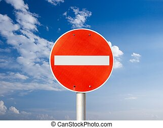 No entry traffic sign against blue sky