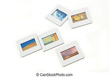 Five color slides with plastic frames. - Five color slides...