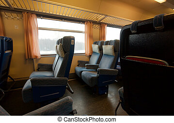Train - Comfortable seats in the interior of a train wagon