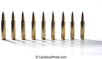 Bullets Standing - Row of shiny rifle bullets isolated on...