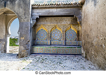 Tiled and carved alcove in Casbah, Tangier with distant...