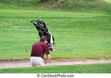 sand trap - Man caught in the sand trap