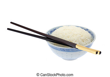 Bowl of cooked rice with chopsticks in isolated white...