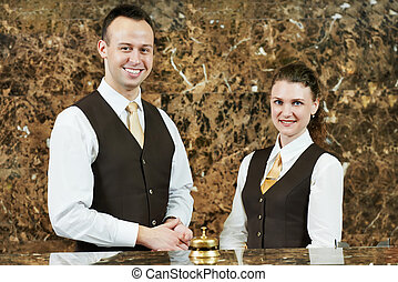Hotel worker on reception - Receptionist or concierge...