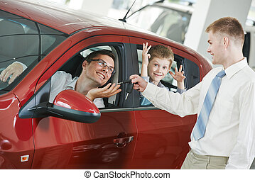 Car selling or auto buying - Car salesperson sells new...