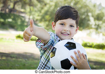 Cute Young Boy Playing with Soccer Ball in Park - Cute Young...