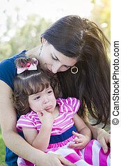 Loving Mother Consoles Crying Baby Daughter