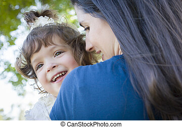 Cute Laughing Baby Girl and Mother in Park