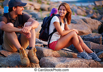 Little rest - Pretty hiker looking at her boyfriend while...