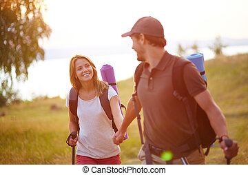 Summer trip - Portrait of couple of happy hikers walking in...