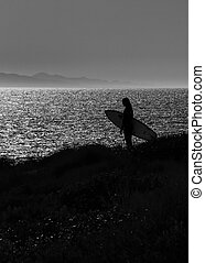 Silhouette of a surfer - Silhouette of surfer gazing the...